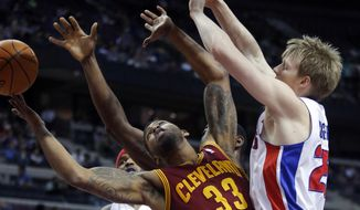 Cleveland Cavaliers forward Alonzo Gee looses the ball against Detroit Pistons guard Kyle Singler, right, during the first half of an NBA basketball game Wednesday, Feb. 12, 2014, in Auburn Hills, Mich. (AP Photo/Duane Burleson)
