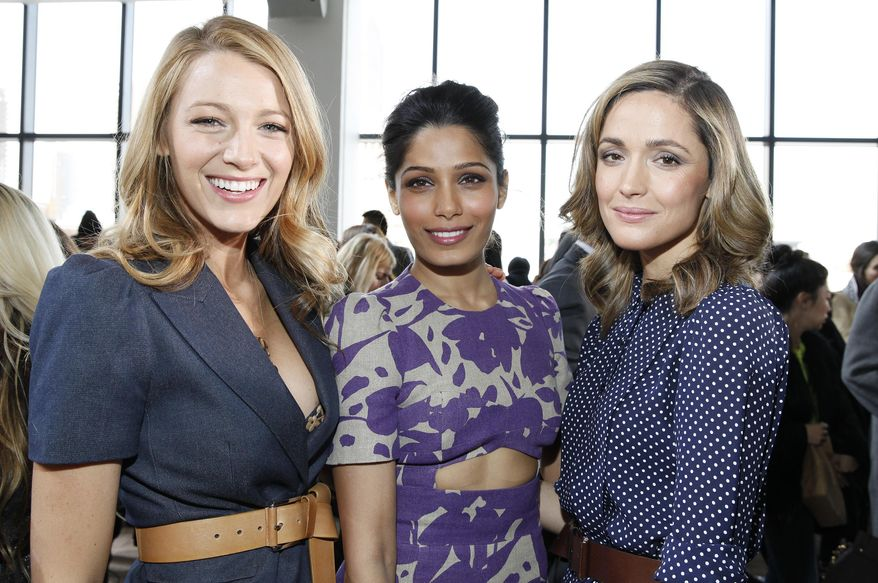 Actresses, from left, Blake Lively, Freida Pinto and Rose Bryne attend the Michael Kors 2014 Fall/Winter Collection during Mercedes Benz Fashion Week on Wednesday, Feb. 12, 2014, in New York. (Photo by Amy Sussman/Invision/AP)