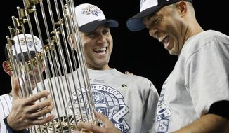"FILE - In this Nov. 4, 2009, file photo, New York Yankees' Derek Jeter, left, and Mariano Rivera look at the championship trophy after winning the Major League Baseball World Series against the Philadelphia Phillies, in New York. Jeter says he will retire after this season ""with absolutely no regrets,"" ending one of the greatest careers in the history of baseball's most storied franchise.The 39-year-old New York captain posted a long letter on his Facebook page Wednesday, Feb. 12, 2014,  saying that 2014 will be his final year. (AP Photo/David J. Phillip, File)"