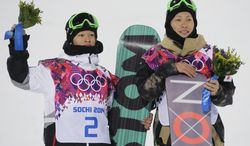 Men's snowboard halfpipe silver medalist Ayumu Hirano of Japan, left, and bronze medalist Taku Hiraoka, alson Japan, pose on the podium at the Rosa Khutor Extreme Park, at the 2014 Winter Olympics, Tuesday, Feb. 11, 2014, in Krasnaya Polyana, Russia.   (AP Photo/Andy Wong)