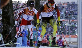 Germany's gold medal winner Eric Frenzel, right, and Japan's silver medal winner Akito Watabe ski during the cross-country portion of the Nordic combined at the 2014 Winter Olympics, Wednesday, Feb. 12, 2014, in Krasnaya Polyana, Russia. (AP Photo/Gregorio Borgia)