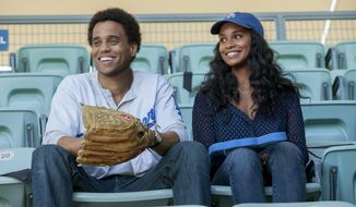 "This image released by Sony Pictures shows Michael Ealy, left, and Joy Bryant in a scene from ""About Last Night."" (AP Photo/Sony Pictures, Matt Kennedy)"