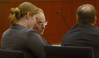 Eric Millerberg, center, and his defense attorneys Haylee Mills, left, and Randall Marshall, right, listen to opening statements by Deputy Weber County prosecuting attorney Chris Shaw, Wednesday, Feb. 12, 2014, in Ogden, Utah. Millerberg has been charged with injecting his 16-year-old baby sitter, Alexis Rasmussen, with a fatal dose of heroin and methamphetamine, then taking his wife and infant daughter along to dump Rasmussen's body near a river. (AP Photo/The Salt Lake Tribune, Leah Hogsten, Pool)