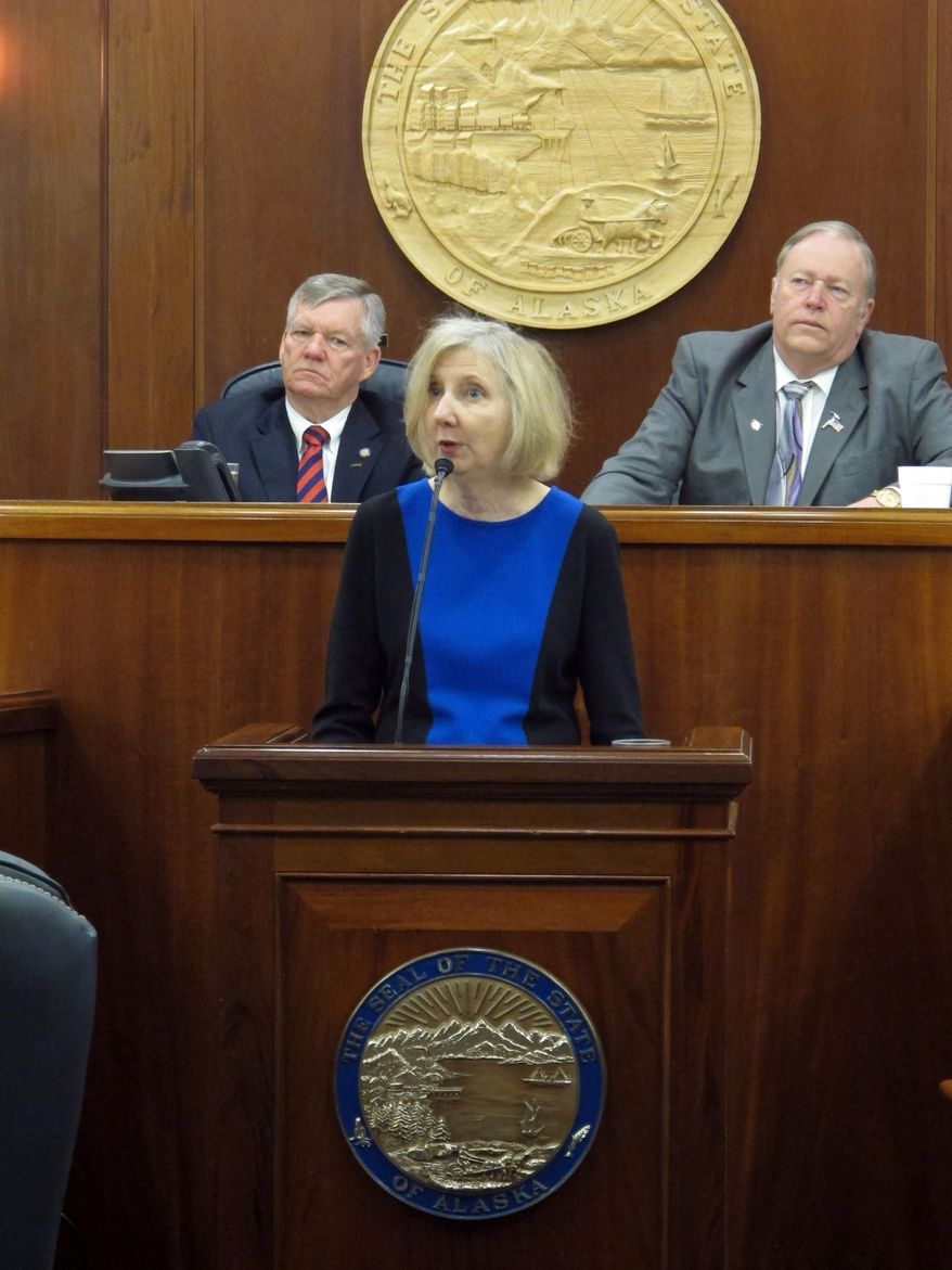 Dana Fabe, the chief justice of the Alaska Supreme Court, delivers the State of the Judiciary address to a joint session of the Alaska Legislature on Wednesday, Feb. 12, 2014, in Juneau, Alaska. Shown behind her are Senate President Charlie Huggins, left, and House Speaker Mike Chenault, right. (AP Photo/Becky Bohrer)