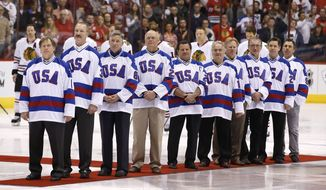 "Members of the gold medal 1980 ""Miracle on Ice"" U.S. Olympic hockey team are honored prior to an NHL hockey game between the Chicago Blackhawks and the Phoenix Coyotes, Friday Feb. 7, 2014, in Glendale, Ariz. (AP Photo/Ross D. Franklin)"