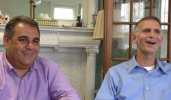 **FILE** Michael De Leon (left) and Gregory Bourke filed suit on July 26, 2013 challenging Kentucky's ban on same-sex marriage. Bourke and De Leon, both of Louisville, Ky., were married in Canada in 2004. Their home state does not offer legal recognition of the union. The suit filed in federal court in Louisville is the first to challenge Kentucky's law. (Associated Press)