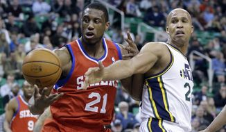 Philadelphia 76ers' Thaddeus Young (21) and Utah Jazz's Richard Jefferson, right, battle for a rebound in the first quarter of an NBA basketball game on Wednesday, Feb. 12, 2014, in Salt Lake City. (AP Photo/Rick Bowmer)