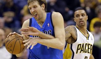 Indiana Pacers guard George Hill, right, reaches around Dallas Mavericks forward Dirk Nowitzki during the second half of an NBA basketball game in Indianapolis, Wednesday, Feb. 12, 2014. The Mavericks defeated the Pacers 81-73. (AP Photo/Michael Conroy)