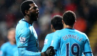Tottenham Hotspur's Emmanuel Adebayor, left, celebrates his goal with his teammates during their English Premier League soccer match against Newcastle United at St James' Park, Newcastle, England, Wednesday, Feb. 12, 2014. (AP Photo/Scott Heppell)