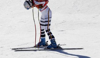 Germany's Maria Hoefl-Riesch rests after finishing the women's downhill at the Sochi 2014 Winter Olympics, Wednesday, Feb. 12, 2014, in Krasnaya Polyana, Russia. (AP Photo/Christophe Ena)