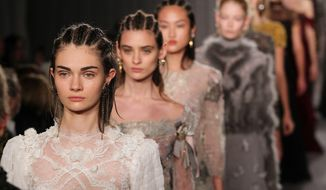 This image released by Starpix shows the Marchesa Fall 2014 collection during Fashion Week in New York, Wednesday, Feb. 12, 2014. (AP Photo/Starpix, Amanda Schwab)