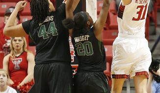 Texas Tech's Haley Schneider (31) scores over Baylor's Kristina Higgins (44) and Imani Wright (20) during an NCAA college basketball game in Lubbock, Texas, Wednesday, Feb. 12, 2014. (AP Photo/The Avalanche-Journal, Tori Eichberger)