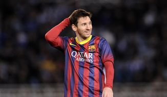FC Barcelona's Lionel Messi of Argentina, gestures during their Spanish Copa del Rey semifinal second leg soccer match against Real Sociedad, at Anoeta stadium, in San Sebastian northern Spain, Wednesday, Feb. 12, 2014. (AP Photo/Alvaro Barrientos)