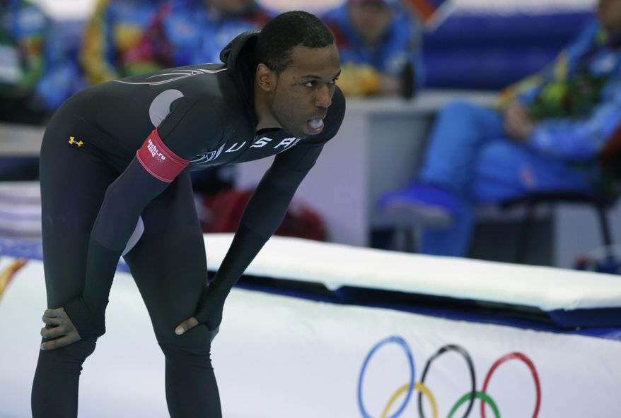 Shani Davis of the U.S. gestures in dejection after competing in the men's 1,000-meter speedskating race at the Adler Arena Skating Center during the 2014 Winter Olympics in Sochi, Russia, Wednesday, Feb. 12, 2014. (AP Photo/Matt Dunham)