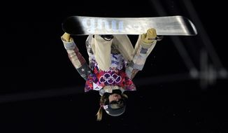 United States' Kaitlyn Farrington competes during the women's snowboard halfpipe final at the Rosa Khutor Extreme Park, at the 2014 Winter Olympics, Wednesday, Feb. 12, 2014, in Krasnaya Polyana, Russia. (AP Photo/Felipe Dana)