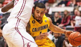 California guard Justin Cobbs (1) drives against Washington State forward D.J. Shelton (23) during the first half of an NCAA college basketball game Wednesday, Feb. 12, 2014, at Beasley Coliseum in Pullman, Wash. (AP Photo/Dean Hare)