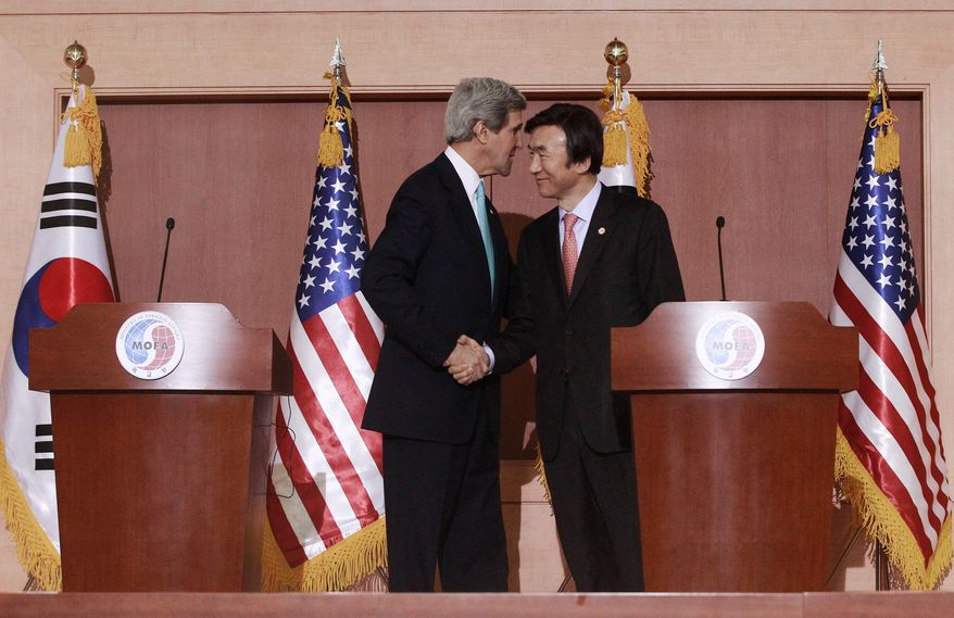 Secretary of State John F. Kerry holds a press conference Thursday in Seoul with South Korean Foreign Minister Yun Byung-se. Mr. Kerry is on a mission aimed largely at easing tensions between China and its smaller neighbors over territorial disputes and exploring ways to restart long-stalled multiparty talks on ridding North Korea of nuclear weapons. (Associated Press)
