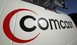 FILE - This Feb. 11, 2011 file photo shows the Comcast logo on one of the company's vehicles, in Pittsburgh. Comcast has agreed to buy Time Warner Cable for $45.2 billion in stock, or $158.82 per share, in a deal that would combine the top two cable TV companies in the nation, according to a person familiar with the matter who spoke on condition of anonymity because it had not been announced formally. An announcement is set for Thursday morning, Feb. 13, 2014, the person said. (AP Photo/Gene J. Puskar, File)