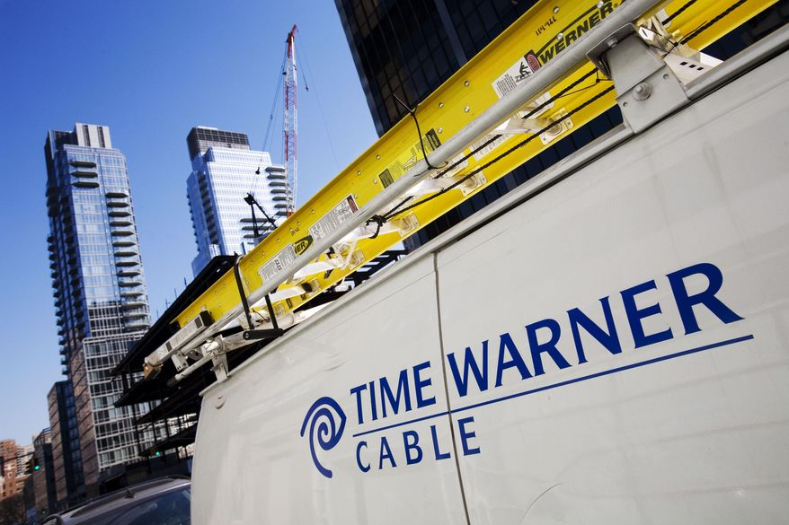 FILE - In this Feb. 2, 2009 file photo, a Time Warner Cable truck is parked in New York. Comcast has agreed to buy Time Warner Cable for $45.2 billion in stock, or $158.82 per share, in a deal that would combine the top two cable TV companies in the nation, according to a person familiar with the matter who spoke on condition of anonymity because it had not been announced formally. An announcement is set for Thursday morning, Feb. 13, 2014, the person said. (AP Photo/Mark Lennihan, File)