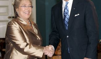 **FILE** Chile's President Michelle Bachelet, left, shakes hands with U.S. Vice President Joe Biden as they pose for pictures at the La Moneda presidential palace in Santiago, Saturday, Mar. 28, 2009. Biden is a one-day official visit to Chile. (AP Photo/Santiago Llanquin)