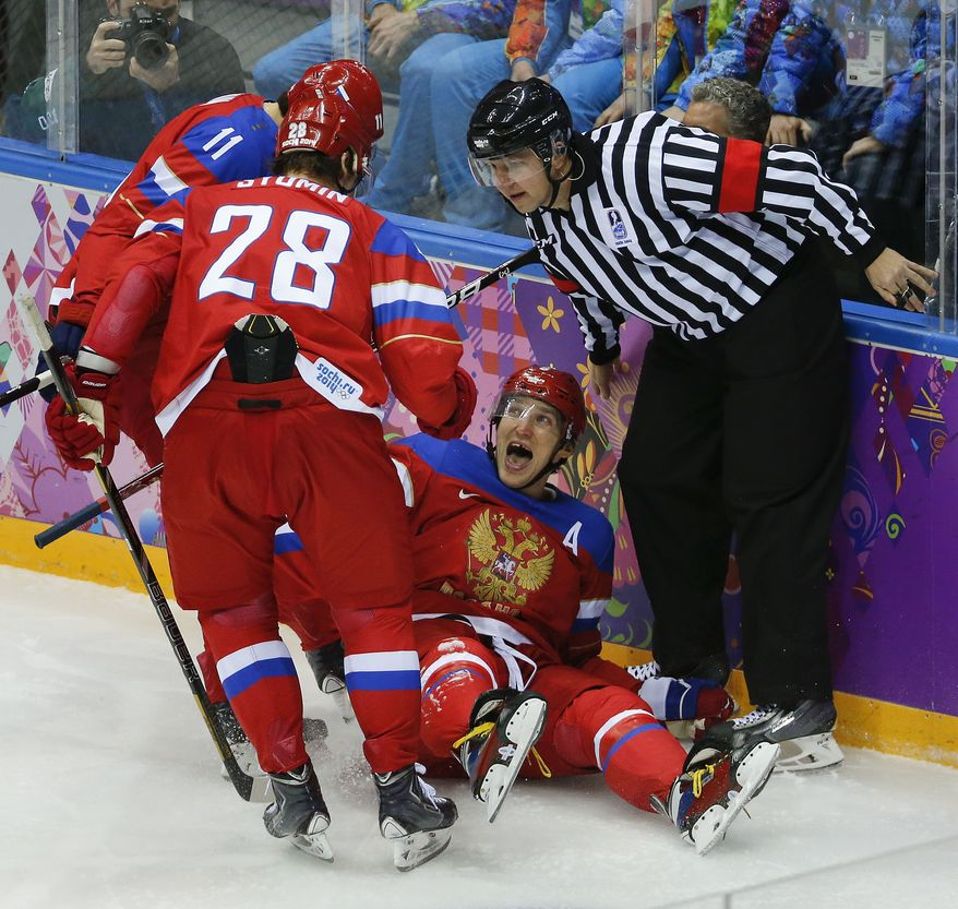 Russia forward Alexander Ovechkin reacts with forward Alexander Syomin and forward Yevgeni Malkin after scoring a goal against Slovenia in the first period of a men's ice hockey game at the 2014 Winter Olympics, Thursday, Feb. 13, 2014, in Sochi, Russia. (AP Photo/Mark Humphrey)