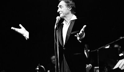 In this April 1965 photo provided by the Las Vegas News Bureau archives, Sid Caesar performs at the Flamingo Hotel in Las Vegas. Caesar, whose sketches lit up 1950s television with zany humor, died Wednesday, Feb. 12, 2014. He was 91. (AP Photo/Las Vegas News Bureau)