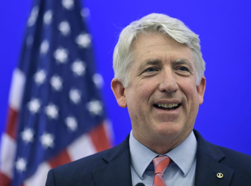 FILE - In this Dec. 18, 2013 file photo, Virginia Attorney General-elect Mark Herring smiles during a news conference at the Capitol in Richmond, Va. A federal judge ruled Thursday, Feb. 13, 2014 that Virginia's ban on same-sex marriage is unconstitutional, making it the first state in the South to have its voter-approved prohibition overturned. (AP Photo/Steve Helber, File)