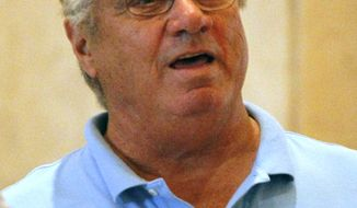 FILE - In this Nov. 12, 2013, file photo, Atlanta Braves scout Jim Fregosi talks in the hallway at the annual baseball general managers meeting in Orlando, Fla. Fregosi is hospitalized in Miami after suffering an apparent stroke while on a cruise for baseball fans.  A spokeswoman for MSC Cruises says the 71-year-old Fregosi became ill Tuesday, Feb. 11, 2014, as the MSC Divina was headed from Grand Cayman to Mexico. The ship returned to Grand Cayman and Fregosi was later taken to a hospital in Florida. (AP Photo/Reinhold Matay, File)