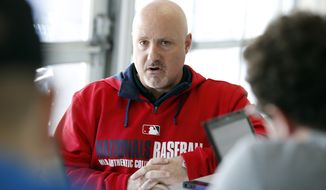 Washington Nationals general manager Mike Rizzo speaks during a media availability at their spring training baseball facility, Thursday, Feb. 13, 2014, in VIera, Fla. (AP Photo/Alex Brandon)