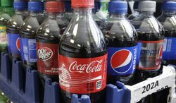 California would become the first state to require warning labels on the front of sodas and other sugary drinks under proposed legislation announced in Sacramento, Calif., Thursday, Feb. 13, 2014.  A bill SB1000,  by Sen. William Monning D-Carmel, would require manufacturers to place warnings on beverage containers that have added sweeteners  that have 75 or more calories in every 12 ounces.  The beverage industry notes that drink containers list the number of calories on the label. (AP Photo/Rich Pedroncelli)