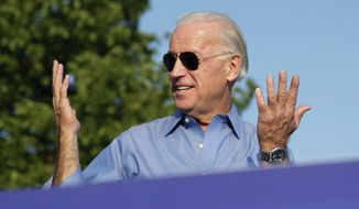 Vice President Joe Biden reacts to a comment by President Obama about his sunglasses, during a Democratic rally in Philadelphia, Sunday, Oct. 10, 2010. (AP Photo/J. Scott Applewhite)