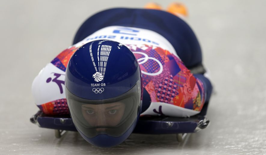 Elizabeth Yarnold of Great Britain starts her third run during the women's skeleton competition at the 2014 Winter Olympics, Friday, Feb. 14, 2014, in Krasnaya Polyana, Russia. (AP Photo/Natacha Pisarenko)