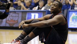 Maryland's Charles Mitchell sits on the court following Duke's 69-67 win over Maryland in an NCAA college basketball game in Durham, N.C., Saturday, Feb. 15, 2014. Duke won 69-67. (AP Photo/Gerry Broome)