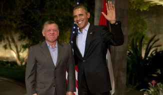 President Barack Obama waves to the media as he greets Jordan's King Abdullah II at The Annenberg Retreat at Sunnylands, Rancho Mirage, Calif., Friday, Feb. 14, 2014. (AP Photo/Jacquelyn Martin)