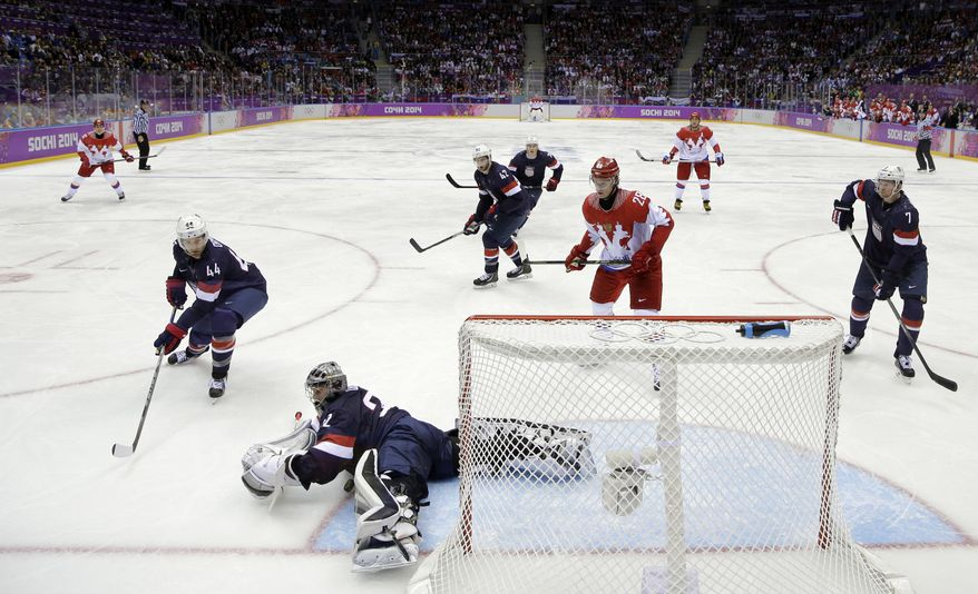 USA goaltender Jonathan Quick makes a save during the third period of a men's ice hockey game against Russia at the 2014 Winter Olympics, Saturday, Feb. 15, 2014, in Sochi, Russia. (AP Photo/Mark Humphrey )