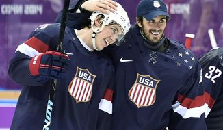 United States forward T.J. Oshie, left, is congratulated by goalie Ryan Miller, right, after Oshie scored the game-winning goal in a shootout against Russia in a men's ice hockey game at the 2014 Winter Olympics, Saturday, Feb. 15, 2014, in Sochi, Russia. The U.S. won 3-2 in a shootout. (AP Photo/The Canadian Press, Nathan Denette)