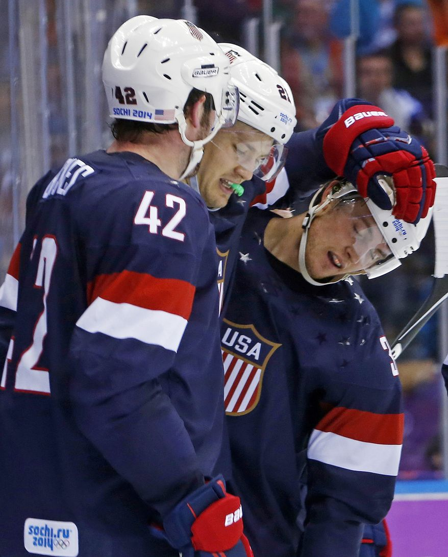 USA forward James van Riemsdyk congratulates USA defenseman Cam Fowler after Fowler scored a goal against Russia in the second period of a men's ice hockey game at the 2014 Winter Olympics, Saturday, Feb. 15, 2014, in Sochi, Russia. (AP Photo/Mark Humphrey)