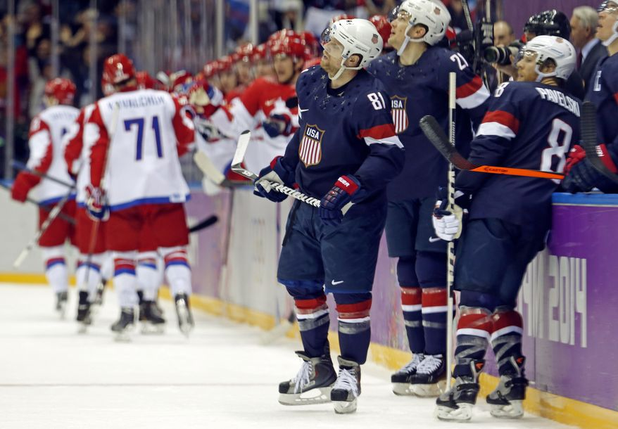 Team USA reacts after a third period goal by Russia during a men's ice hockey game at the 2014 Winter Olympics, Saturday, Feb. 15, 2014, in Sochi, Russia. (AP Photo/Mark Humphrey)