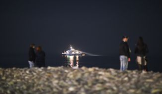 A Russian military vessel patrols the waterfront along the Black Sea, Saturday, Feb. 15, 2014, in central Sochi, Russia, home of the 2014 Winter Olympics. (AP Photo/David Goldman)