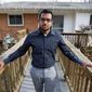 """Yves Gomes, a student at the University of Maryland, who's parents were deported, poses for a photo outside his great uncle's house where he lives in Silver Spring, Md., Friday Jan. 17,  2014. Gomes says he considers himself one of the lucky ones _ lucky, at least, among the so-called """"dreamers."""" Even though his parents were deported and his legal status was once in limbo, today the 21-year-old Indian native attends the University of Maryland paying in-state tuition.  ( AP Photo/Jose Luis Magana)"""