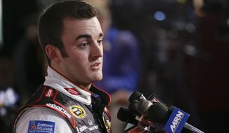 Driver Austin Dillon answers reporters questions during NASCAR auto racing media day at Daytona International Speedway in Daytona Beach, Fla., Thursday, Feb. 13, 2014. (AP Photo/John Raoux)