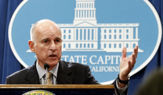 FILE  - In a May 14, 2012, file photo Gov. Jerry Brown discusses his revised state budget plan during a Capitol news conference in Sacramento, Calif., Monday, May 14, 2012. A rift between Gov. Jerry Brown and the board overseeing the nation's largest public pension fund over rising liabilities tied to longer retiree life expectancies highlights a concern about how decisions are made at an agency with tremendous influence over state finances. (AP Photo/Rich Pedroncelli, )