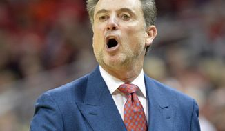 Louisville coach Rick Pitino shouts instructions to his team during the first half of an NCAA college basketball game against Rutgers on Sunday, Feb. 16, 2014, in Louisville, Ky. (AP Photo/Timothy D. Easley)