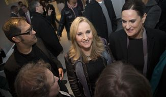 FILE - In this Dec. 9, 2013, file photo taken for the Arcus Foundation, singer-songwriter Melissa Etheridge mingles with guests at the launch of Uprising of Love, a social movement dedicated to supporting the Russia Freedom Fund, in New York. The Russia Freedom Fund, founded by Melissa Etheridge, Linda Wallem, Dustin Lance Black, Bruce Cohen and Greg Propper, works for long-term, systemic change in the status and treatment of Russia's LGBT community. (John Minchillo / AP Images for Arcus Foundation, File)