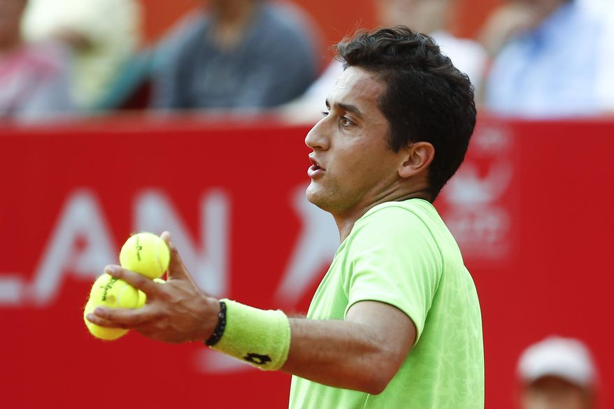 Spain's Nicolas Almagro complains to the umpire about a call during a Buenos Aires' Copa Claro Open semifinal tennis match with Spain's David Ferrer in Buenos Aires, Argentina, Saturday, Feb. 15, 2014. (AP Photo/Victor R. Caivano)