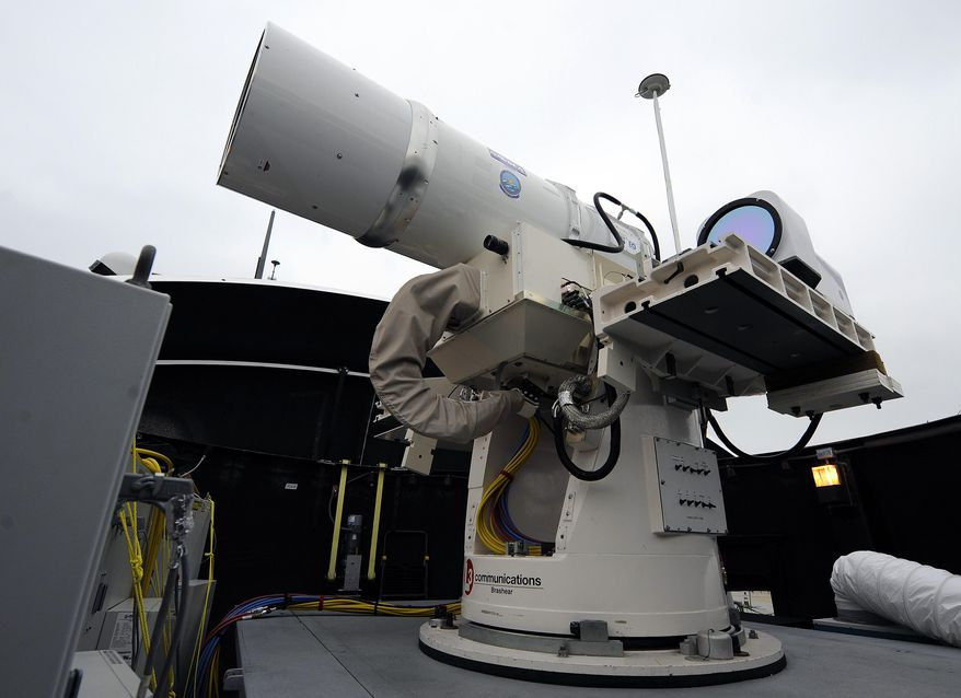 ** FILE ** In this July 30, 2012, photo provided by the U.S. Navy, a laser weapon sits temporarily installed aboard the guided-missile destroyer USS Dewey in San Diego. The Navy plans to deploy its first laser on a ship in 2014 and intends to test an electromagnetic rail gun prototype aboard a vessel within the following two years. (AP Photo/U.S. Navy, John F. Williams)