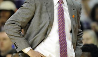 Clemson head coach Brad Brownell watches the action during the first half of an NCAA college basketball game against Virginia Saturday, Feb. 15, 2014, at Littlejohn Coliseum in Clemson, S.C.(AP Photo/ Richard Shiro)