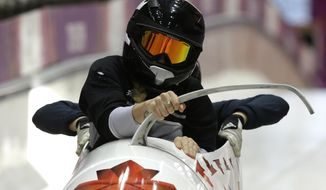The team from the Canada CAN-1, piloted by Kaillie Humphries, start a run during a women's bobsleigh training session at the 2014 Winter Olympics, Saturday, Feb. 15, 2014, in Krasnaya Polyana, Russia. (AP Photo/Dita Alangkara)