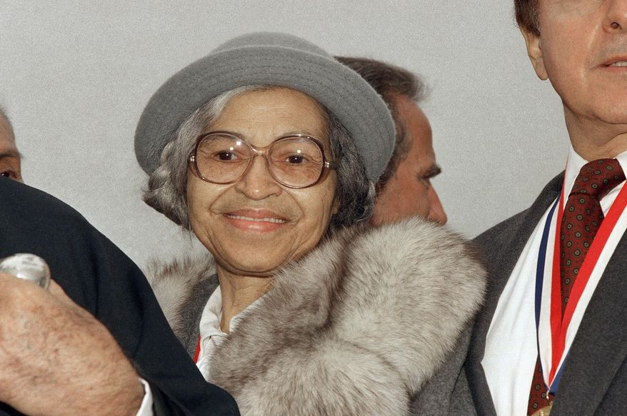 This Oct. 28, 1986, file photo shows Rosa Parks at Ellis Island in New York. (AP Photo, File) **FILE**