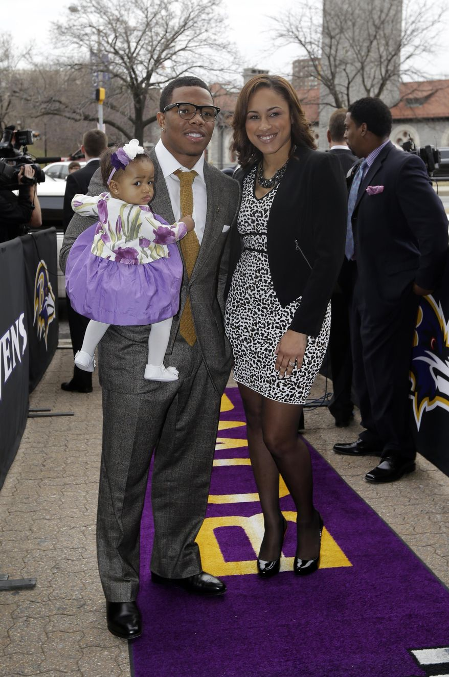 FILE - In this March 11, 2013 file photo, Baltimore Ravens running back Ray Rice, left, poses with his daughter, Rayven, and Janay Palmer as they arrive for a screening of a new film released on DVD that chronicles the team's championship NFL football season in Baltimore. Police in Atlantic City say Ray Rice and his fiance, Janay Palmer, were released on Saturday, Feb. 15, 2014, after they were arrested when an argument turned physical at the Revel Casino. (AP Photo/Patrick Semansky, File)